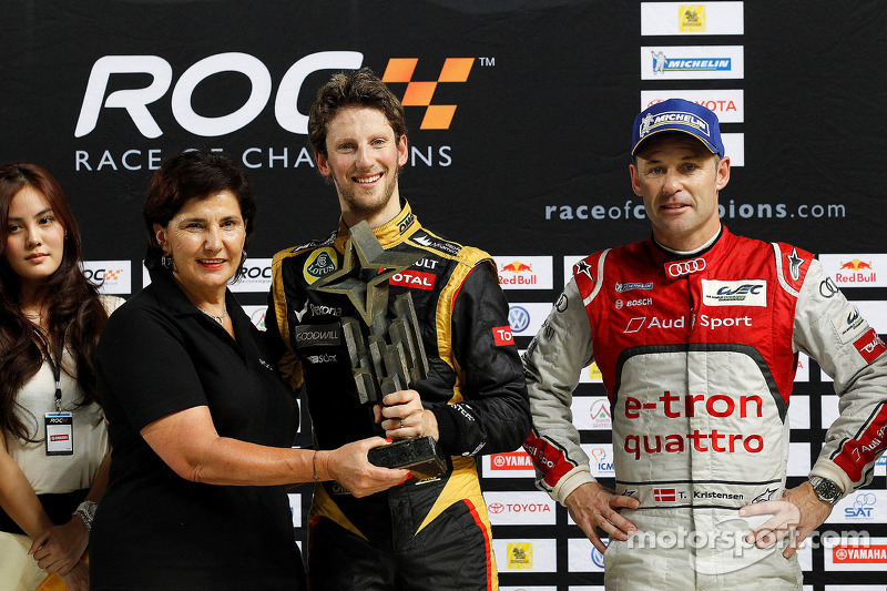 Winner Romain Grosjean celebrates with second place Tom Kristensen and Michel Mouton