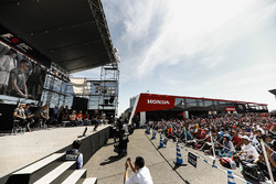 Stoffel Vandoorne, McLaren, Jenson Button, McLaren, on the F1 stage