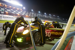 Pit stop for #30 MOMO/NGT Motorsport Porsche GT3: Jakub Giermaziak, Henrique Cisneros, Sean Edwards,