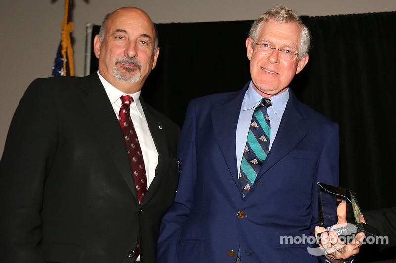 Miles Collier receives the Bob Akin award from Bobby Rahal