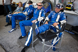 Justin Wilson, John Pew and Justin Wilson and Oswaldo Negri watch as A.J. Allmendinger battles for the lead with one hour to go