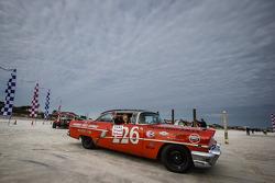 Vintage race cars parade on the beach