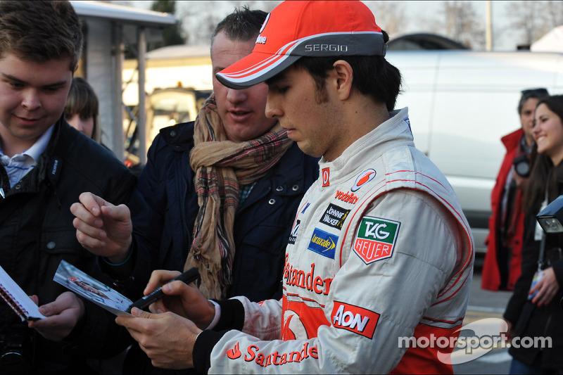 Sergio Perez, McLaren signs autographs for the fans