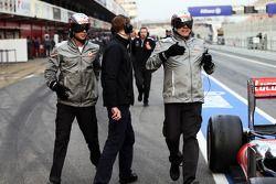 McLaren mechanics recover the McLaren MP4-28 of Jenson Button, McLaren in the pit lane