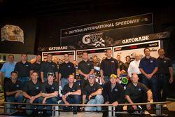2013 Daytona 500 winning team poses: Jimmie Johnson, Rick Hendrick, Chad Knaus and crew members