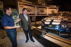 2013 Daytona 500 winner Jimmie Johnson, Hendrick Motorsports Chevrolet, with NASCAR President Mike Helton