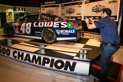 2013 Daytona 500 winner Jimmie Johnson, Hendrick Motorsports Chevrolet, takes photos of his car