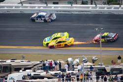 Travis Kvapil, BK Racing Toyota, Paul Menard, Richard Childress Racing Chevrolet and Joey Logano, Penske Racing Ford crash on the last lap