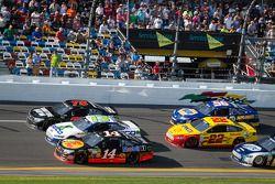 Kurt Busch, Furniture Row Racing Chevrolet, Casey Mears, Germain Racing Ford and Tony Stewart, Stewart-Haas Racing Chevrolet battle