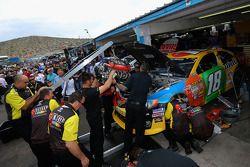 Crew members replace the engine of Kyle Busch, Joe Gibbs Racing Toyota