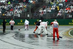 Marshals clear track, rain water