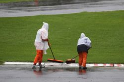 Marshals clear rain water from circuit
