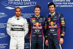 The top three qualifiers in Parc Ferme, Mercedes AMG F1, third; Sebastian Vettel, Red Bull Racing, p