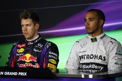 (L to R): Pole sitter Sebastian Vettel, Red Bull Racing and Lewis Hamilton, Mercedes AMG F1 in the F