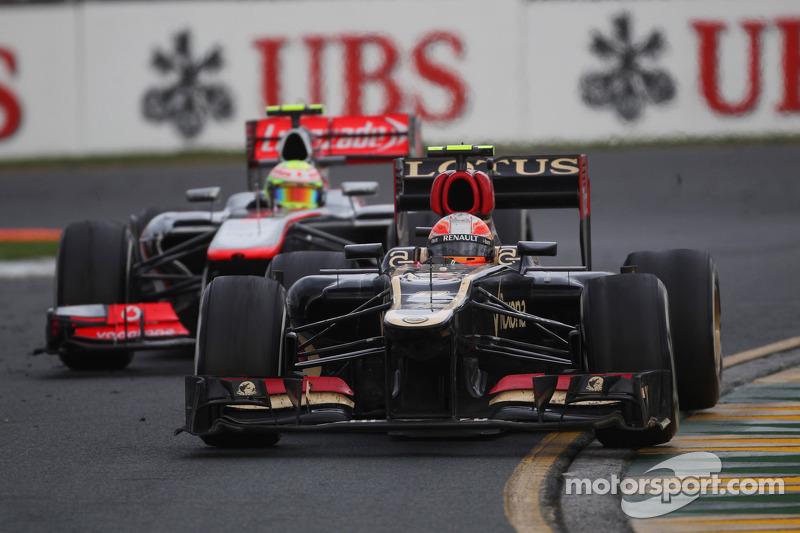 Romain Grosjean, Lotus F1 E21 y Sergio Pérez, McLaren MP4-28
