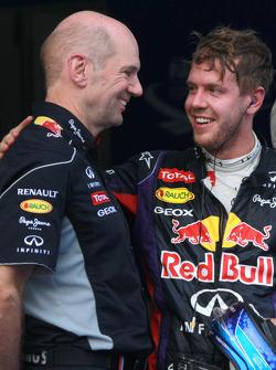 Race winner Sebastian Vettel, Red Bull Racing RB9 celebrates in parc ferme with Adrian Newey