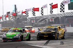 Jack Baldwin, GTSport Racing/Porsche Cayman S leads Andy Lee, Best IT Racing Chevrolet Camaro into T