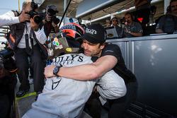 GTC pole winner Andy Lally celebrates with Patrick Dempsey