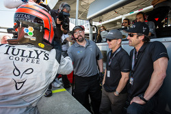 GTC pole winner Andy Lally celebrates with Patrick Dempsey and Joe Foster