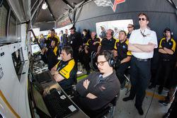Corvette Racing team members watch qualifying