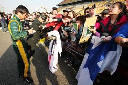 Ma Qing Hua, Caterham F1 Reserve Driver signs autographs for the fans