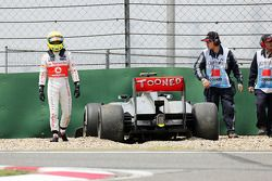 Sergio Perez, McLaren MP4-28 crashed at the pit entrance at the end of the first practice session
