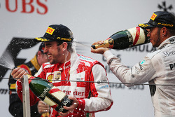 Race winner Fernando Alonso, Ferrari celebrates on the podium with third placed Lewis Hamilton, Mercedes AMG F1
