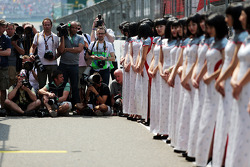 Photographers and grid girls on the drivers parade
