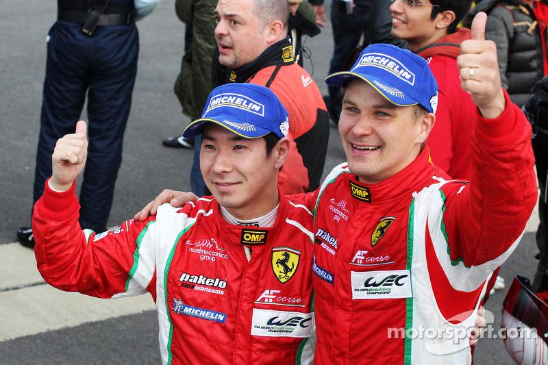 Kamui Kobayashi and Toni Vilander celebrate second place in GT