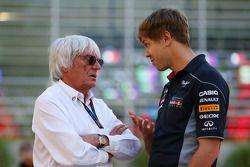(L to R): Bernie Ecclestone, CEO Formula One Group, talks with Sebastian Vettel, Red Bull Racing