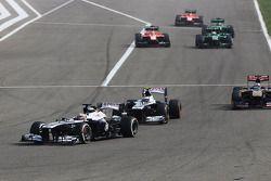 Pastor Maldonado, Williams FW35 leads Valtteri Bottas, Williams FW35