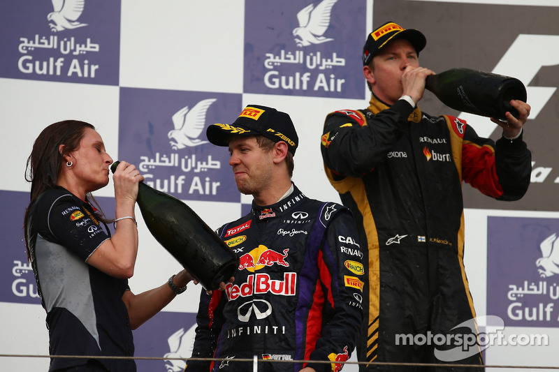 First place for Sebastian Vettel, Red Bull Racing with Gill Jones, Red Bull Racing and Second place Kimi Raikkonen, Lotus F1 Team
