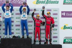 Overall podium: winners Scott Pruett and Memo Rojas, third place Jon Fogarty, Alex Gurney