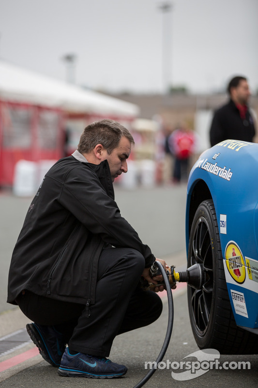 Pit crew installing fresh rubber