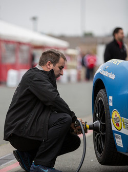 Pit crew installing fresh rubber