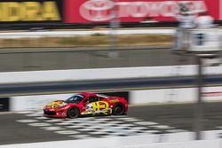 Carlos Kauffmann in the #24 crossing the finish line under a checkered flag