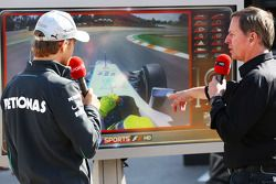 (L to R): Pole sitter Nico Rosberg, Mercedes AMG F1 with Martin Brundle, Sky Sports Commentator