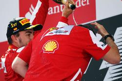 Race winner Fernando Alonso, Ferrari celebrates on the podium with Stefano Domenicali, Ferrari General Director