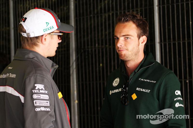(L naar R): Nico Hulkenberg, Sauber met Giedo van der Garde, Caterham F1 Team
