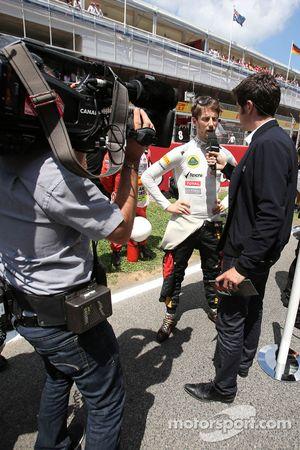 Romain Grosjean, Lotus F1 Team et Thomas Sénécal, Canal+