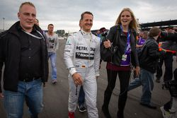 Michael Schumacher arrives at the Formula One exhibition lap