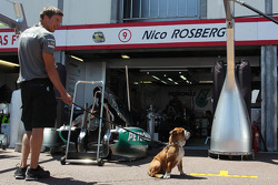 Roscoe, the dog owned by Lewis Hamilton, Mercedes AMG F1, with a Mercedes AMG F1 mechanic