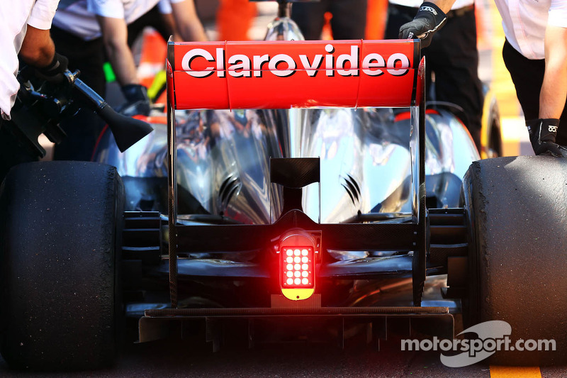 Sergio Perez, McLaren MP4-28 stops at the end of the pit lane