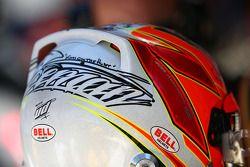 The helmet of Kimi Raikkonen, Lotus F1 Team on the grid as the race is stopped