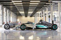 Los coche de carrera de Mercedes de Stirling Moss y Lewis Hamilton