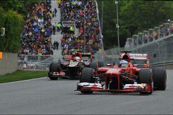 Fernando Alonso, Ferrari F138 leads Romain Grosjean, Lotus F1 E21