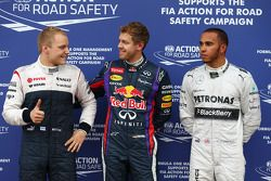 Polesitter Sebastian Vettel, Red Bull Racing, second place Lewis Hamilton, Mercedes AMG F1, third place Valtteri Bottas, Williams F1 Team