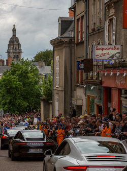 Porsches fill the streets of Le Mans