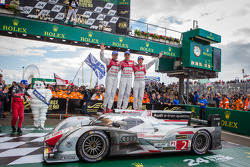 Race winners Tom Kristensen, Allan McNish and Loic Duval celebrate