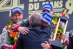 LMP1 podium: Tom Kristensen and Loic Duval with Jacky Ickx and Dr. Wolfgang Ullrich